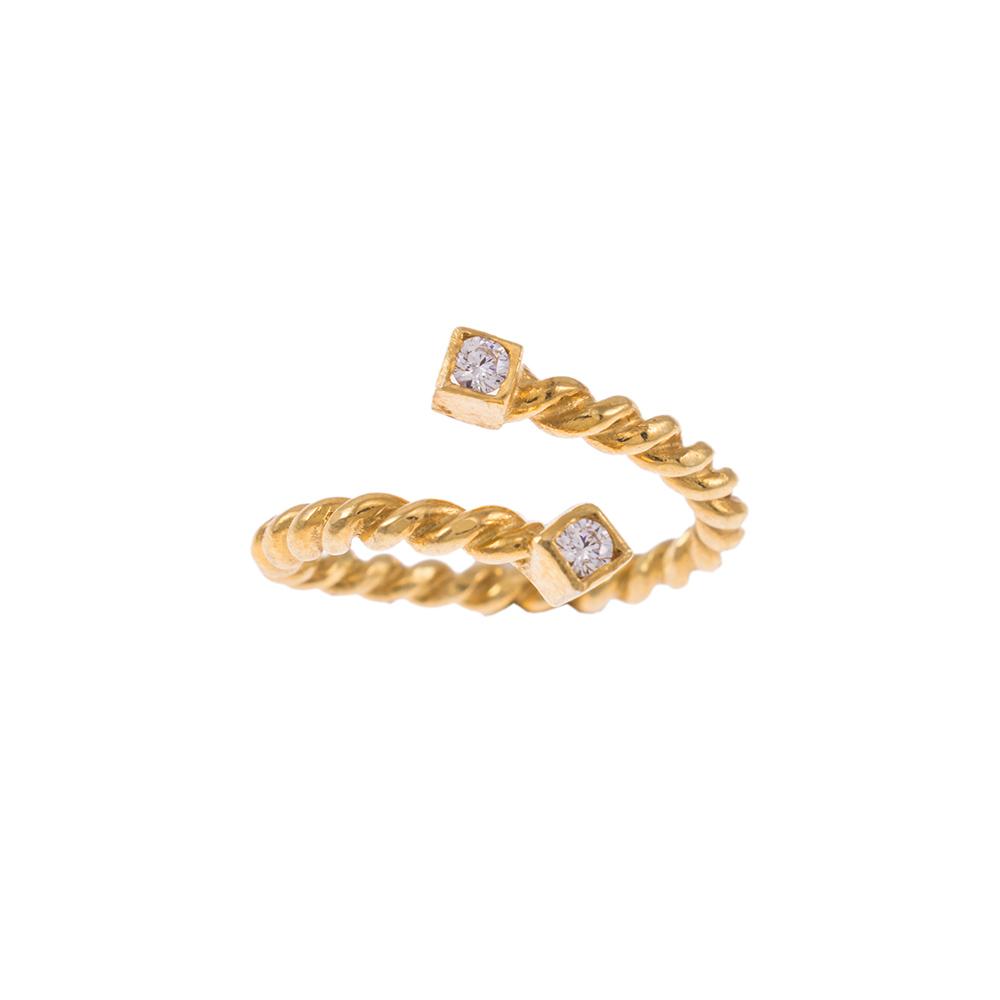 """Δακτυλίδι """"TWIST"""" σε κίτρινο χρυσό 14ΚΤ με  ζιργκόν στίς δύο άκρες."""