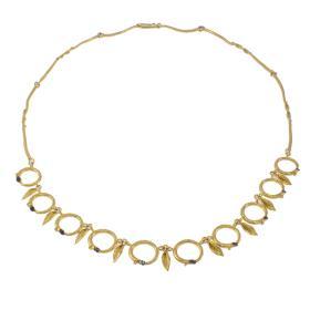 """Κολιέ  """"CYCLES""""   σε κίτρινο 14 ΚΤ χρυσό με μικρά φύλλα."""