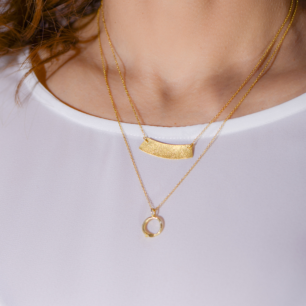 """Pendant """"CYCLES""""  in yellow gold 14 kt."""