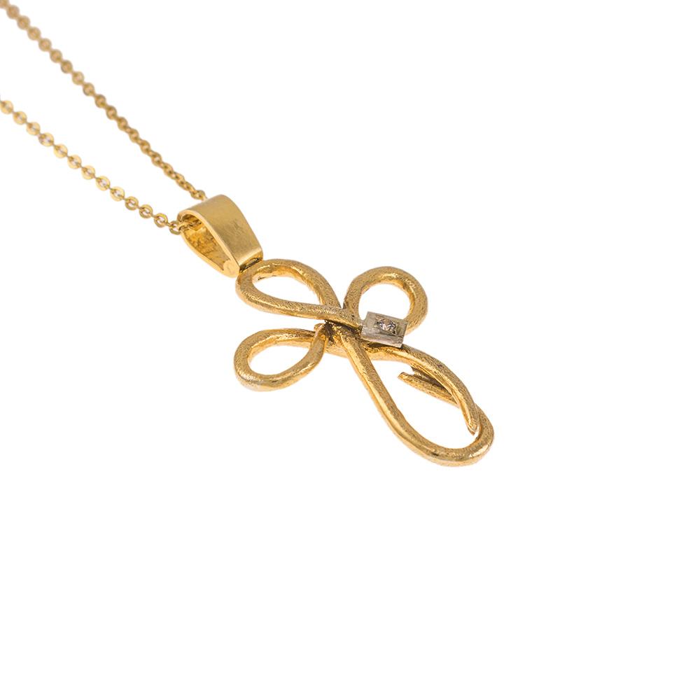 """Σταυρός """"RIBBON"""" σε κίτρινο χρυσό 14ΚΤ με ζιργκόν."""
