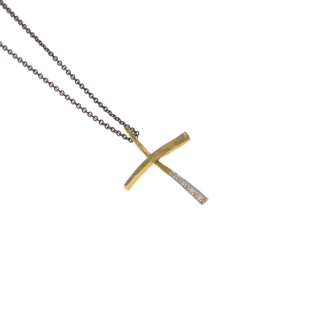 Σταυρός σε κίτρινο χρυσό 14ΚΤ  με ζιργκόν στο κάτω μέρος της κάθετης πλευράς.