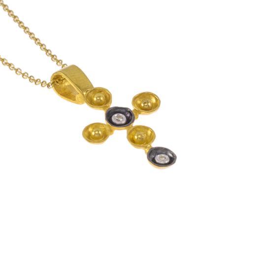 """Σταυρός """"CAVES"""" σε κίτρινο χρυσό 14ΚΤ με ζιργκόν."""